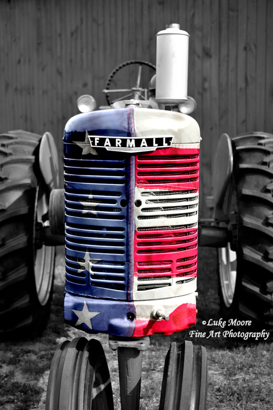 American Flag patriotic classic Farmall tractor barn wall art and fine art prints by photographer Luke Moore.