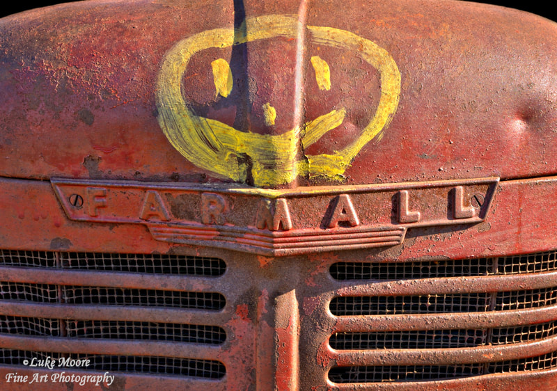 Rusty Farmall tractor fine art prints and farmhouse style decor by Luke Moore.