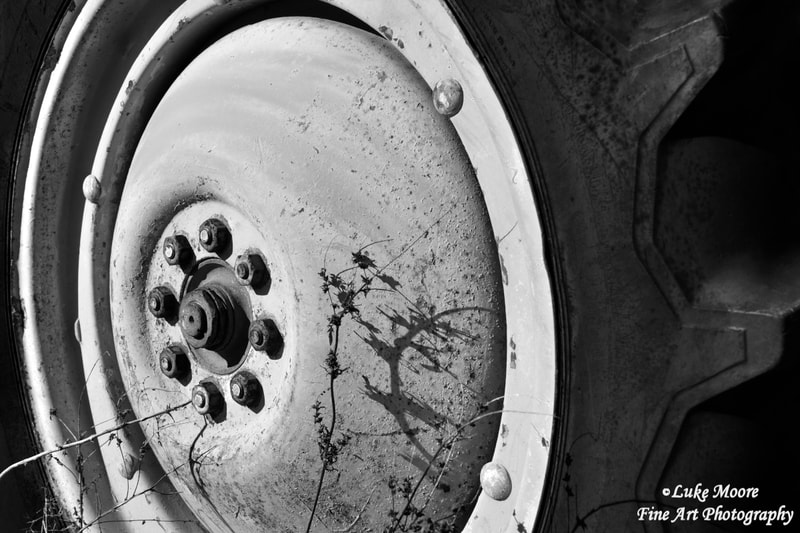 Rustic farmhouse Ford 8N  tractor wheel wall art and wall decor by photographer Luke Moore. Art prints for sale.